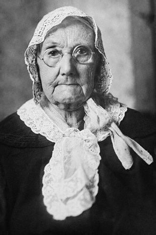 18 Nov 1925, Newton, Kansas, USA --- Newton, Kansas: She\'s Lived Through Four Wars. Above is pictured Mrs. Elizabeth Reese, more familiarly known as Grandma Reese in this section of the country, who recently celebrated her 97th birthday. Not only has she lived through the wars of 1845, 1861, 1898 and 1917, but members of her family have served in all of them. Her first husband was killed in the war with Mexico; her second husband fought during the Civil War. --- Image by Bettmann/CORBIS