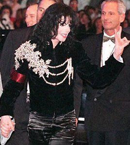 In royal military jacket at Elizabeth Taylor's birthday celebration in 1997