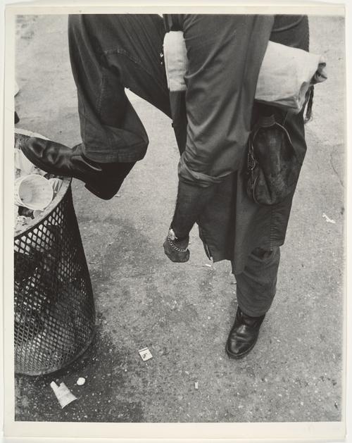 Street Scene: Man Resting Foot on Lip of Trashcan, New York City, 1970s