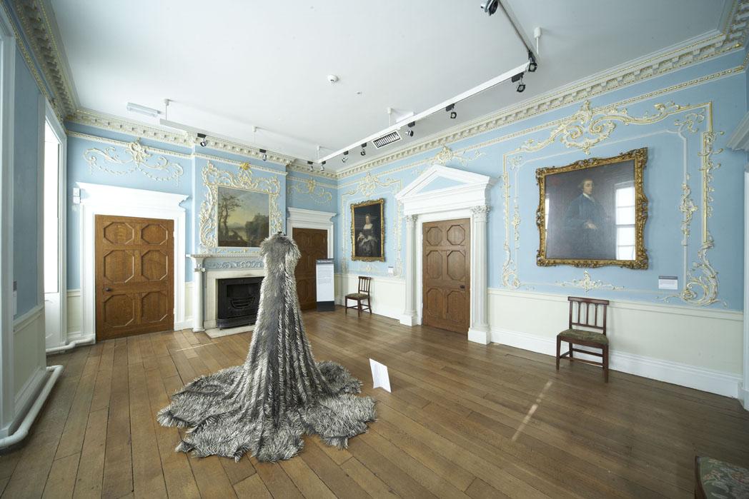"The dining room gallery of Platt Hall displaying Susie MacMurray's ""Widow"""
