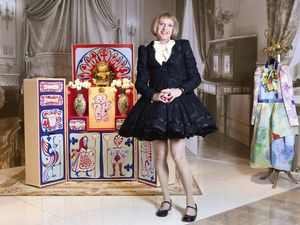 Grayson Perry as Claire with his Louis Vuitton trunk, photo Terry Pengilley at independent.co.uk