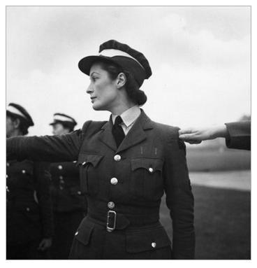A WAAF cadet in training lines up on parade, RAF Bridgenorth, Shropshire, 1941 Beaton, Cecil © Crown Copyright: IWM (HU 112283)