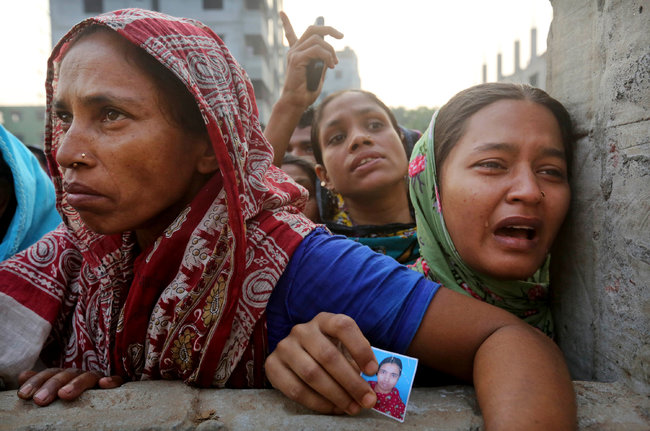 Women waiting to hear news of those missing in the collapse of Rana Plaza on April 24. Photo: Kevin Frayer/AP