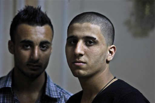 """Ayman al-Sayed, 19, right, with his hair cut, and his friend Mohammed Hanouna, 18, left, pose for photo during an interview in Gaza City, Sunday, April 7, 2013."" Photo: Adel Hana."