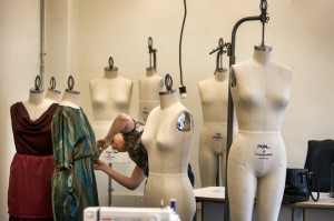 Student Pina Succi, left works putting one of her creations on a mannequin in a class. Image courtesy of Michael Mancuso/The Times via NJ.com