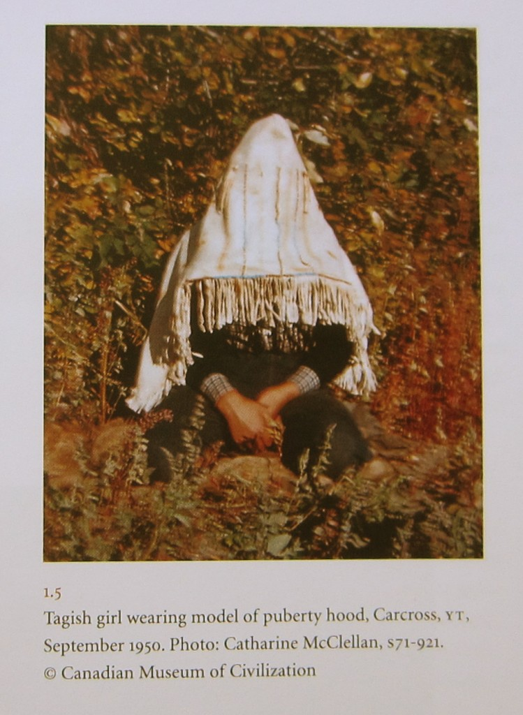 """Tagish girl wearing model of puberty hood, September 1950."" Printed in ""Women's Work, Women's Art"" by Judy Thompson (2013). Page 13. Photo copyright Catherine McClellan/Canadian Museum of Civilization."
