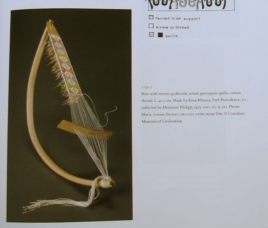 """Bow with woven quillwork; wood, porcupine quills, cotton thread."" From the Canadian Museum of Civilization. Printed in ""Women's Work, Women's Art"" by Judy Thompson (2013). Page 65."