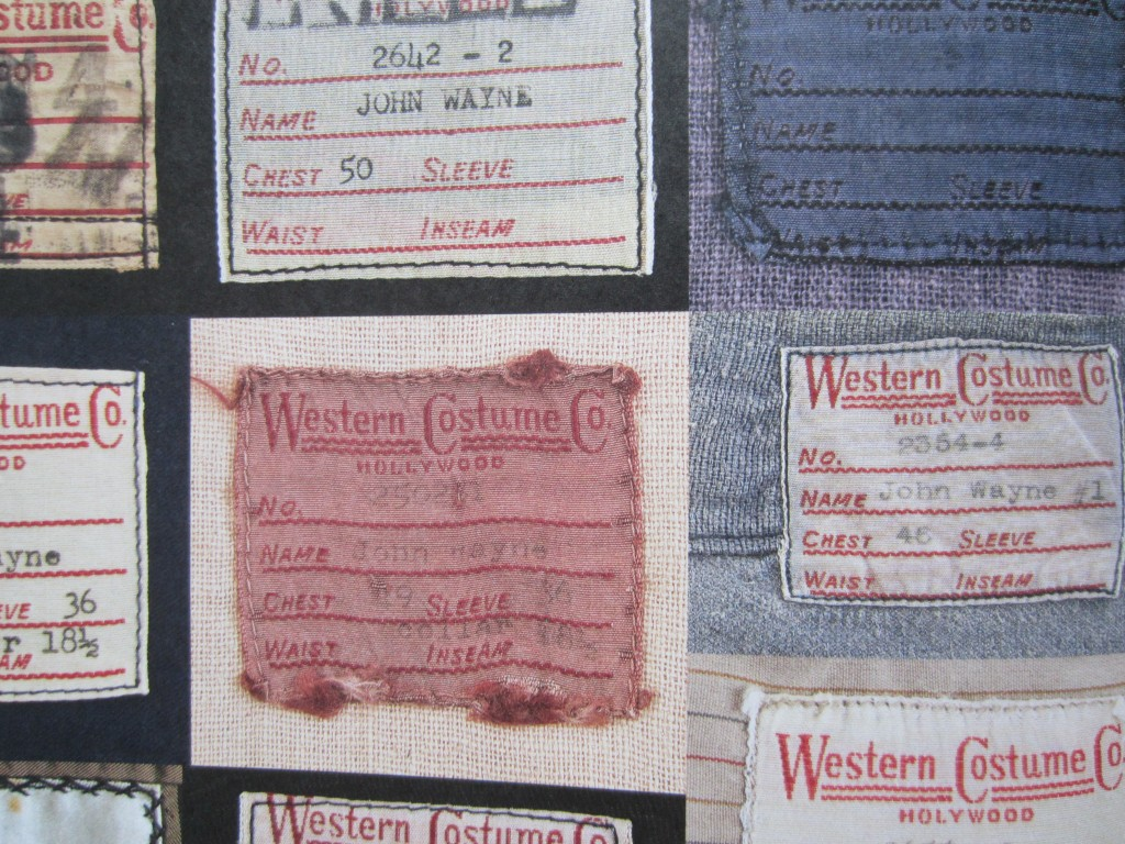 "Detail of back page of small booklet dedicated to Wayne's costumes showing labels from Western Costume Company. From ""John Wayne: The Genuine Article"" by Michael Goldman, 2013."