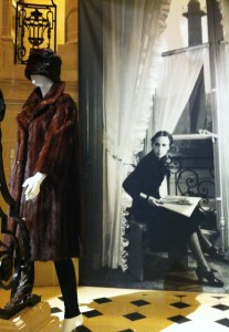 Schiaparelli observing her own brand's fur coat and a Lanvin hat.