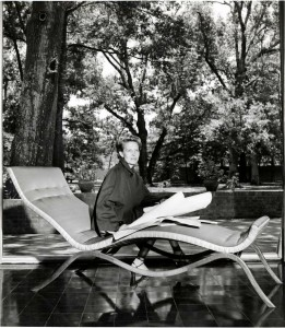 Dominique de Menil wearing a Charles James designed day suit seated on a chaise longue of his design, patio of Menil House. The Menil Archives, the Menil Collection, Houston. Courtesy of Charles James, Jr. and Louise James. Photo: F. Wilbur Seiders