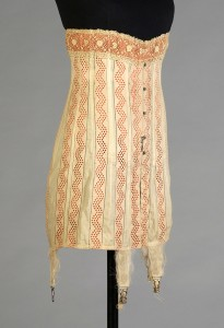 Corset of cotton eyelet over orange ribbons American, 1914  KSUM 1983.3.52 Photograph by Joanne Arnett