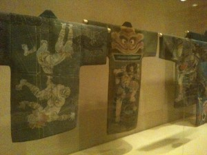 Installation view of 19th century fireman's jacket's, Kimono: A Modern History Photo by the author