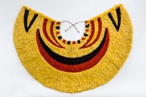 'Ahu 'ula (cape), pre-1861. Yellow and black 'ō'ō (Moho nobilis) feathers, red 'i'iwi (Vestiaria coccinea) feathers, and olonā (Touchardia latifolia) fiber, 16 3/4 x 36 in. (42.5 x 91.4 cm). Bernice Pauahi Bishop Museum, Ethnology Collection