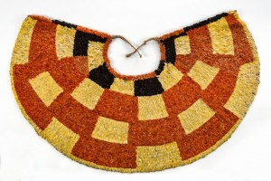'Ahu 'ula (cape), possibly late 18th–early 19th century. Red 'i'iwi (Vestiaria coccinea) feathers, yellow and black 'ō'ō (Moho sp.) feathers, and olonā (Touchardia latifolia) fiber, 27 1/2 x 42 1/8 in. (70 x 107 cm). Bernice Pauahi Bishop Museum, Ethnology Collection