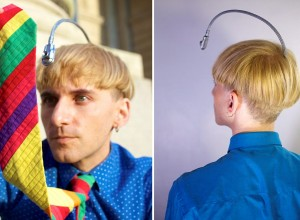 Neil Harbisson who has the world's first cyberg atenna implant. See SWNS story SWCYBORG; A colour blind artist has become the world's first 'eyeborg' after having an antenna implanted into his skull so he can HEAR colours - without even looking at them. Neil Harbisson, 31, has been wearing an external electronic eye for around 10 years which picks up colour frequencies through a camera and transforms them into sound vibrations. But the Brit - who suffers from a rare complete colour blindness - has convinced surgeons to implant the chip inside his skull so that he can perceive even more intricate colours.