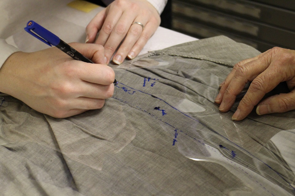 Demonstration of Mylar tracing technique. Key details and points are added at this stage. The process of tracing and measuring is repeated several times to ensure an accurate pattern.