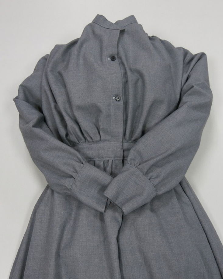The reconstruction of the ward dress in a poly-cotton blend. The button holes were hand-stitched according to the original dress.