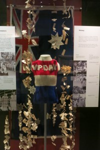 Miss Lois Martin's Victory in the Pacific Day vest displayed on torso mount. Australian War Memorial