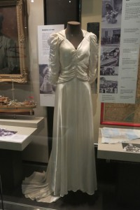 Handmade silk wedding dress, c 1940s, displayed on headless mannequin. Australian War Memorial.