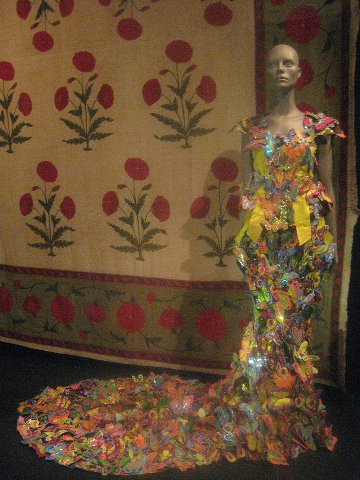 Butterfly dress designed by Manish Arora, spring/summer 2008  Silk satin base with reflective vinyl machine stitched and embroidered butterflies, applique silk, and vinyl. Length 167.5 cm (dress) 112 cm (train). Manish Arora Collection