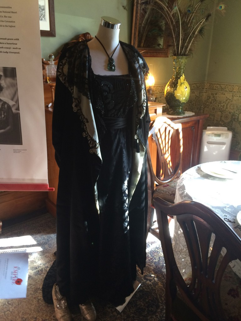 The outfit imagined for Lady Hiria Pomare: a silk damask gown and a Liberty of London coat both from c1915.