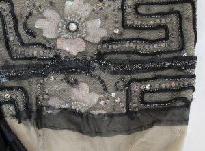 Evening gown, Worthing Museum. Beaded tulle bib