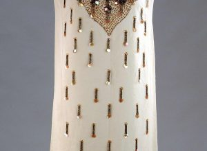 Cocktail dress with beaded tags. El Jay, Auckland War Memorial Museum, 1995-133-1.